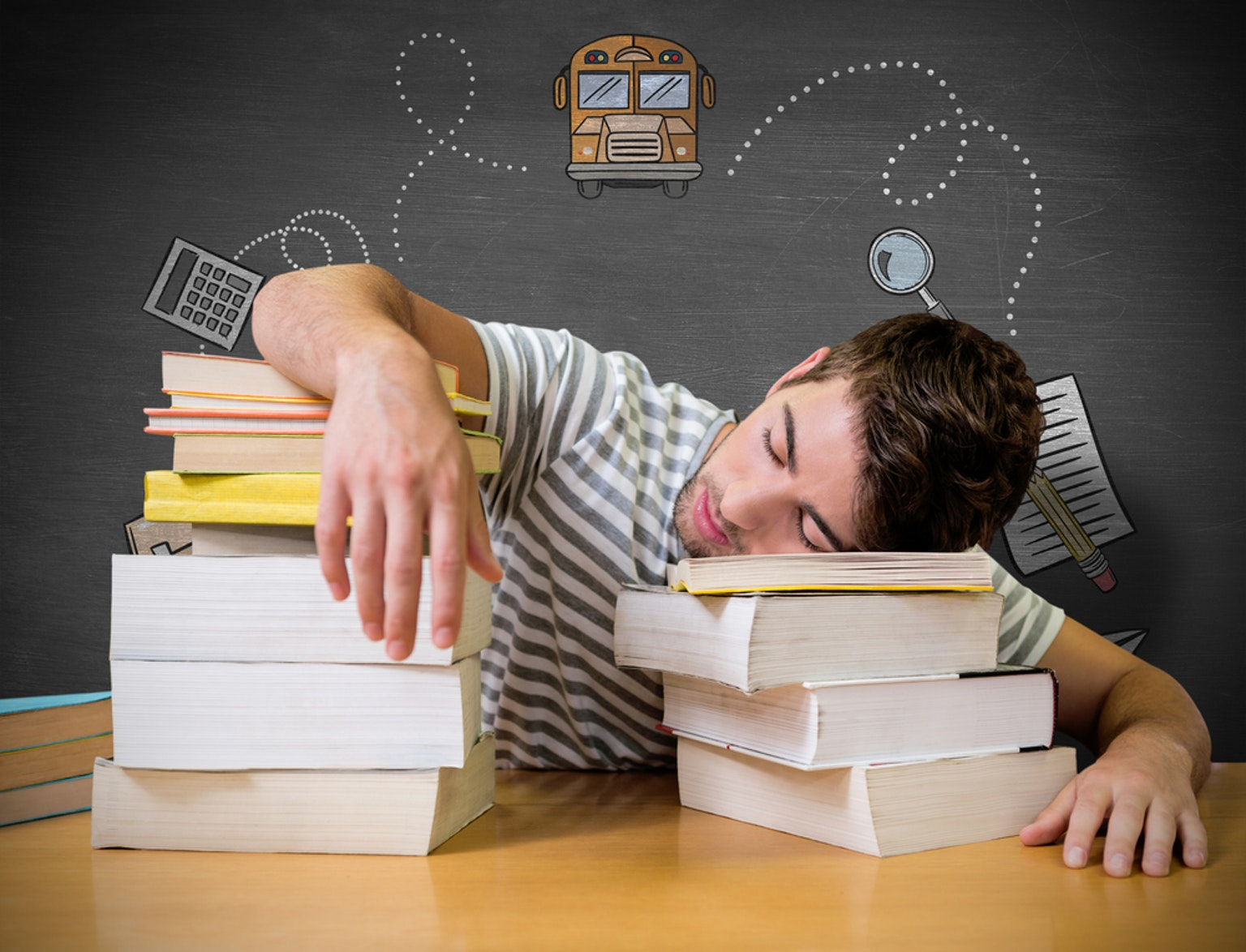 Student sleeping with head and arms on books