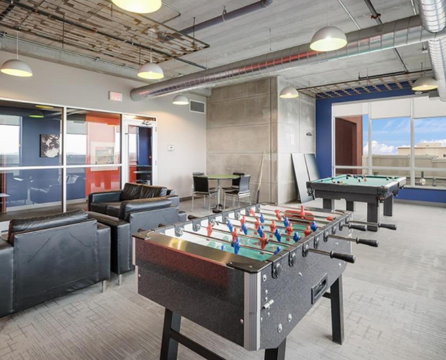 Games room with couches, foosball and pool table
